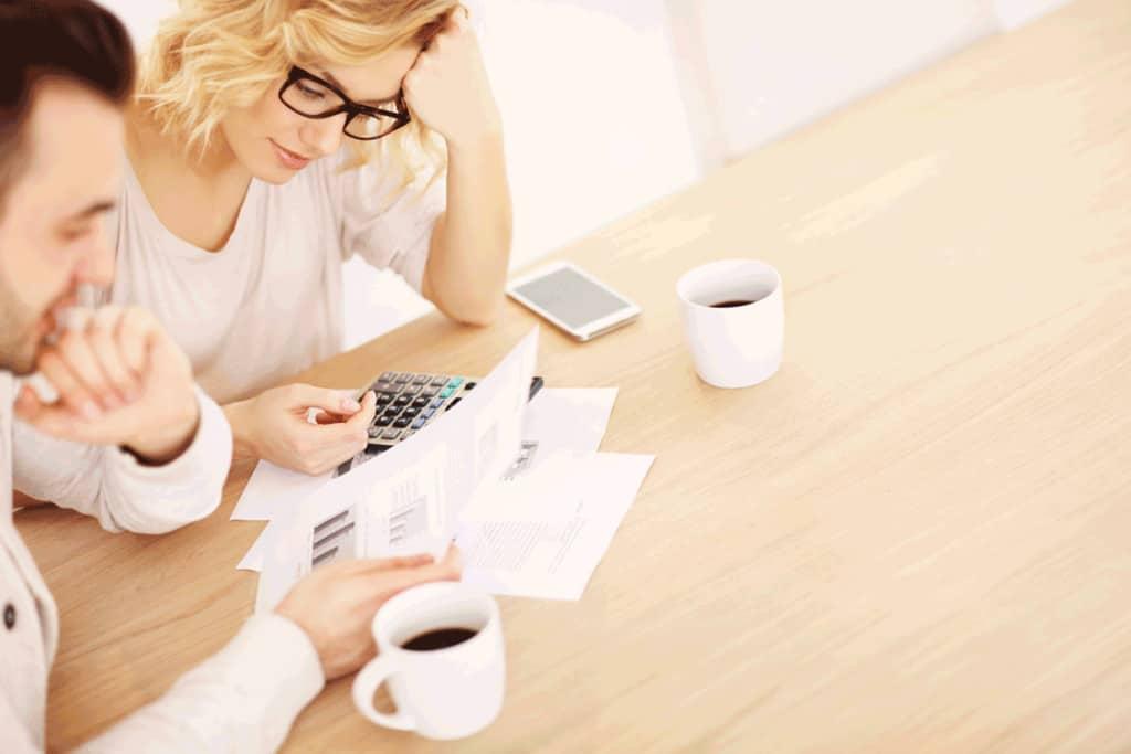 Couple Budgeting Money Dumpster Rental