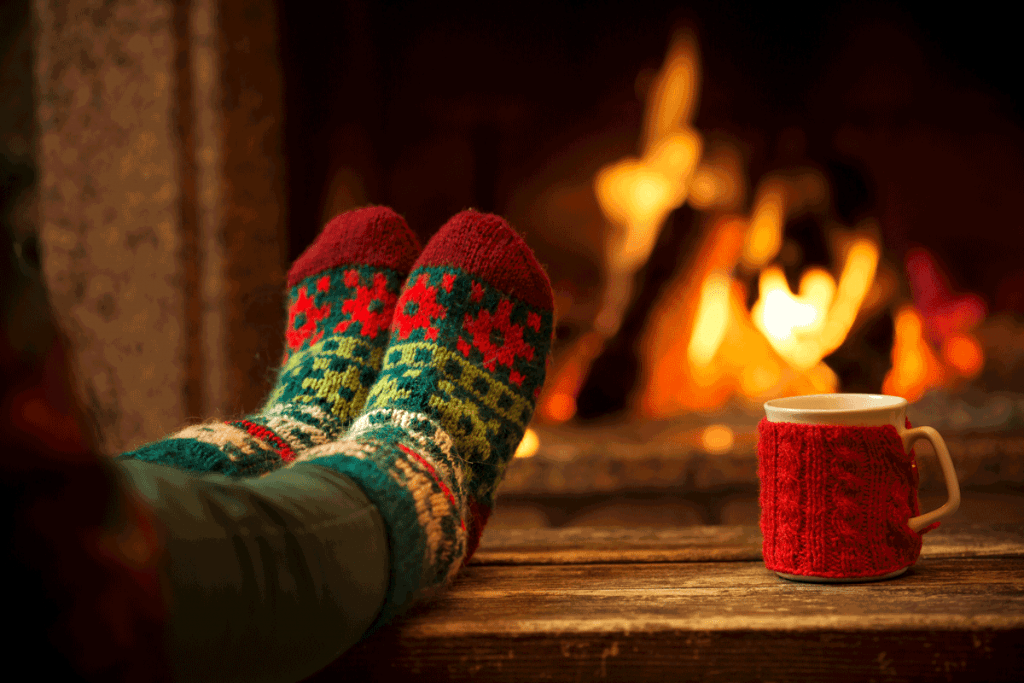 Warming feet in front of fireplace.